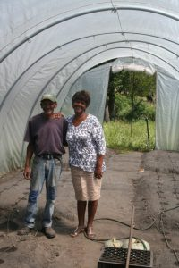 Lettie and gardener Frans in the small scale production unit with drip irrigation where they will soon harvest vegetables to supplement the school feeding program
